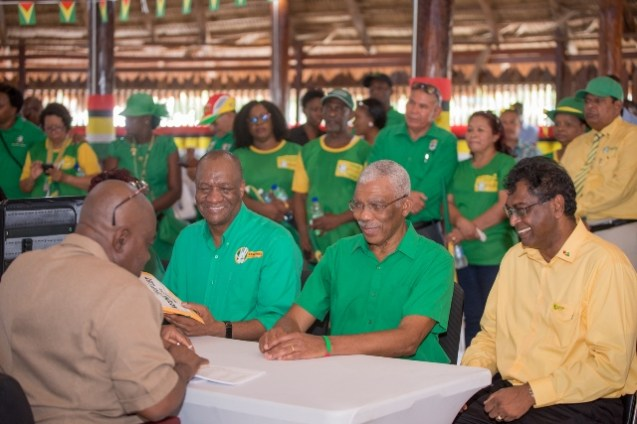 From left: President David Granger Minister of Public Security, Khemraj Ramjattan and Director General of the Ministry, Joseph Harmon handing over their list of candidates to Chief Elections Officer of the Guyana Elections, Keith Lowenfield.