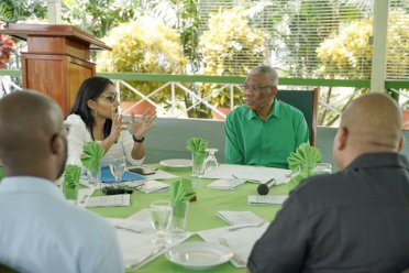 President David Granger pays keen attention to Heal Guyana's Founder, Mrs. Sharon Lalljee- Richard as she makes her point during a round table discussion held at the Baridi Benab, State House compound.