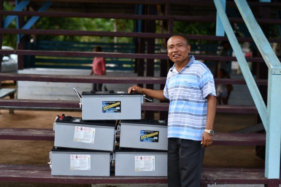 Headteacher of Lake Tapakuma Primary School, Haslyn Williams with the donated batteries