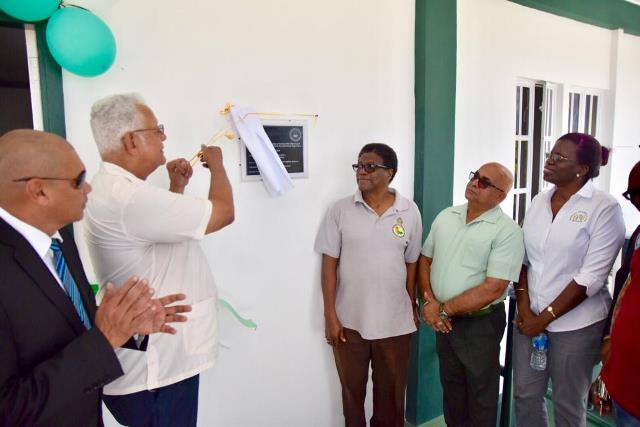 (from left) Minister of Business Haimraj Rajkumar, Minister of Agriculture Noel Holder unveiling the plaque on the new NDIA regional office, CEO of NDIA Frederick Flatts, Regional Executive Officer, Denis Jaikarran and Ministry of Agriculture Permanent Secretary Delma Nedd look on.