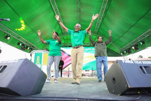 (from left) Minister within the Ministry of Communities with responsibility for Housing, Hon. Annette Ferguson, HE President David Granger and Prime Minister the Hon. Moses Nagamootoo acknowledging the cheers of the crowd.