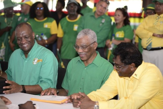 (from left) Directory general Minister of the Presidency Joseph Harmon, His excellency President David Granger and Prime Ministerial candidate and Minister of Public Security Khemraj Ramjattan as they prepare to submit the list of candidates for the APNU+AFC.