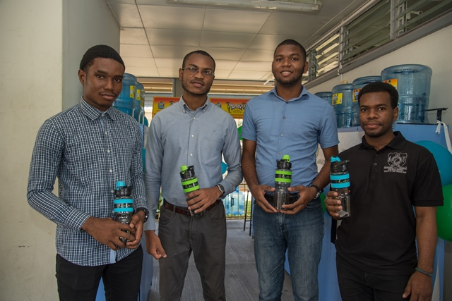 -(from left to right) Electrician, Kevin Austin; Co-founder, Diquan Lewis; Founder, Aaron George; and Technical Advisor, Lyndon Dash pose for a photo.