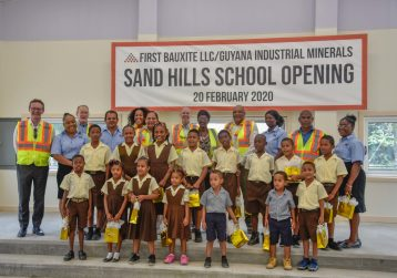 Teacher, students ae joined by Prime Minister Moses Nagamootoo and Minister of natural Resources Raphael Trotman and officials of GINMIN on the stage of New Sand Hills Primary School commissioned