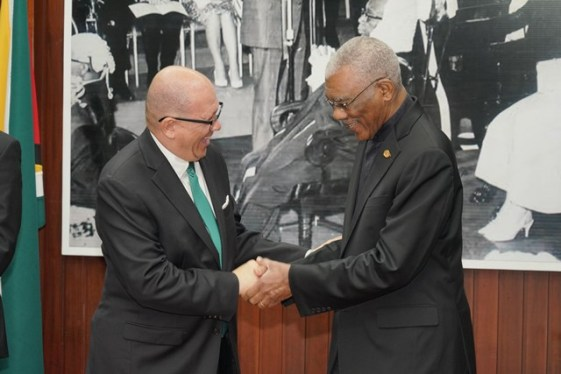 Namibian High Commissioner H.E Neville Gertze and His Excellency David Granger share a light moment.