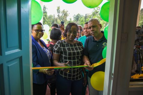 From Left to right; Minister of Public Health Volda Lawrence, Director of Regional and Clinical Services Dr. Kay Shako and Regional Chairman Gordon Bradford cut the ribbon to commission the health post