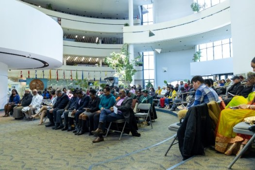 Sections of the Toronto Republic Day flag raising and interfaith ceremony's attendees in prayerful reflection.