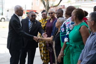 President Granger greets members of the Board of Governors and other representatives of the Bishops High School.