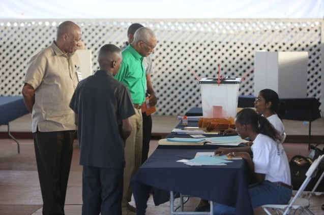 President David Granger while Police Officers Club, Eve Leary observing the process in company of the Director General Joseph Harmon.