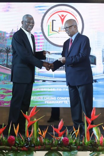 His Excellency, David Granger receives award for the Burnham Education Scholarship Trust (BEST) and STEM Guyana from Banks DIH Chairman, Clifford Reis.