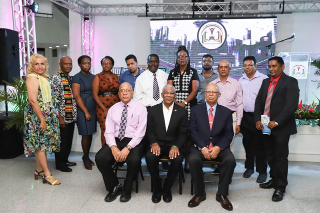 (centre) His Excellency, President David Granger, Banks DIH Chairman, Clifford Reis(right), Human Resources/Trisco Director, Paul Carto (left) along with the recipients.