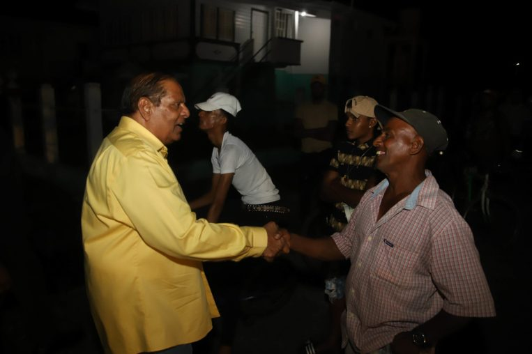Prime Minsiter Moses Nagamootoo greets a resident of Blairmont