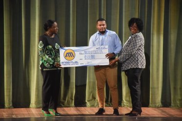 ANSA McAl Public Relations officer, Treiston Joseph (center) presents the Minister of Education, Hon. Dr. Nicolette Henry (left) and Unit of Allied Arts Administrator, Lorraine Barker-King with cheque from ANSA McAl.