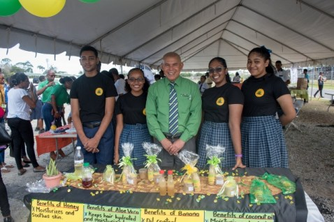 Minister of Social Cohesion, Hon. Dr. George Norton poses with North Georgetown Secondary's Majestic Organic Team at Youth Village 2020.