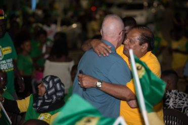 Hon. Moses Nagamootoo, Prime Minister of the Cooperative Republic of Guyana, embraces Dr. Joey Jagan during a political meeting in Region Five