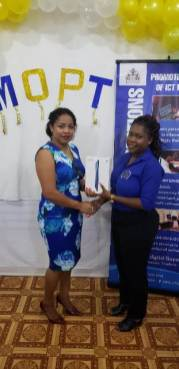 Education Officer attached to the Ministry of Public Telecommunications, Valencia Wren awarding a participant.