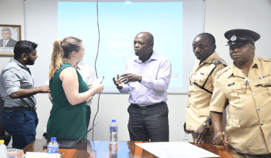 Consultant Ms. Steph Wood (second from left) interacting with Chief Transport Planning Officer, Mr. Patrick Thompson.
