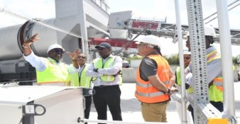 General Manager of the Demerara Harbour Bridge Corporation, Rawlston Adams (left) explains some of the features of the Asphalt Plant to Minister of Public Infrastructure, Hon. David Patterson and team.
