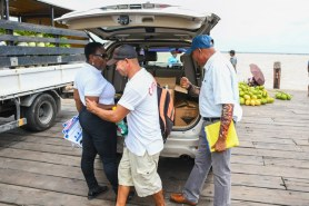 Director General of the Maritime Administration Department, Claudette Rogers distributes cleaning supplies to boating operators at Parika Stelling.