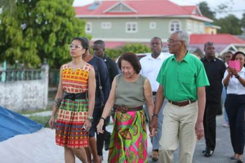 HE President David Granger, First Lady Sandra Granger and their daughter Afuwa Granger make their make to the polling station.