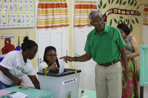 HE President David Granger casts his ballot at the Pearl Nursery School, East Bank Demerara.