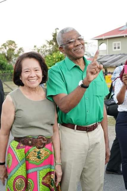 President David Granger shows his inked finger to indicate he has voted. He is accompanied by his wife First Lady Mrs. Sandra Granger