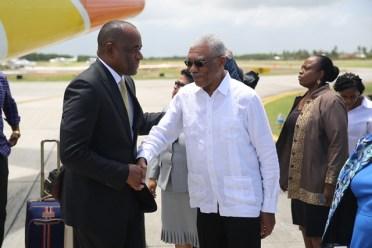 Prime Minister of Dominica, Roosevelt Skerrit greets HE President David Granger.
