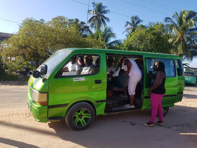A bus providing shuttle services for voters residing in Block 22 who needed to be transported to the Wisburg Secondary School.