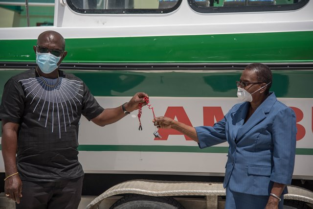 John Adams, Technical Advisor to the Public Health hands over the keys to the river ambulance to Regional Health Officer, Region Ten, Dr. Pansy Armstrong
