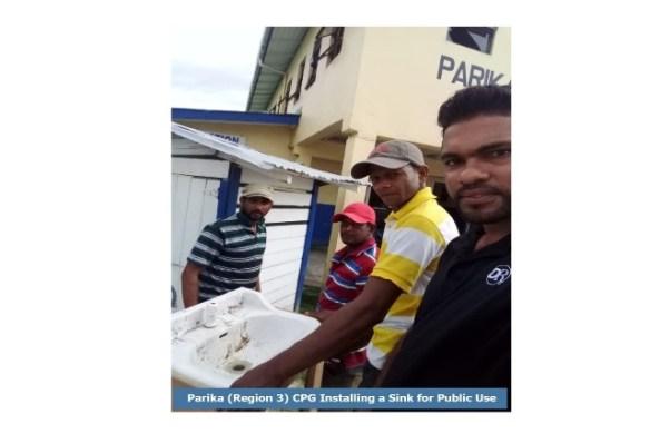 Members of the Parika (Region 3) CPG installing a public sink