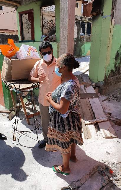 Mayor Ubraj Narine and fire victim Carolyn Martins who lost her Bent street home to fire on April 12.