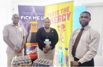 Business Unit Head for Non alcoholic Beverages, Errol Nelson (extreme left) after presenting the beverages to GPHC representatives (Ansa McAl)