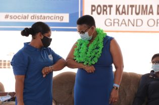 Minister Lawrence is greeted on her arrival to commission the new Port Kaituma District Hospital