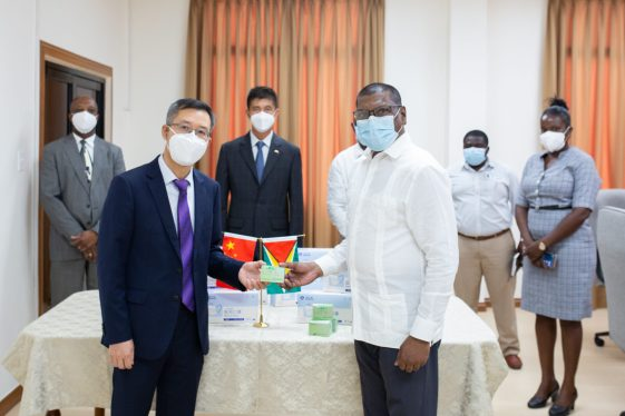 Chen Xilai, Deputy Chief of Missions of the Chinese Embassy in Guyana hand over items to Chief Medical Officer, Dr. Shamdeo Persaud