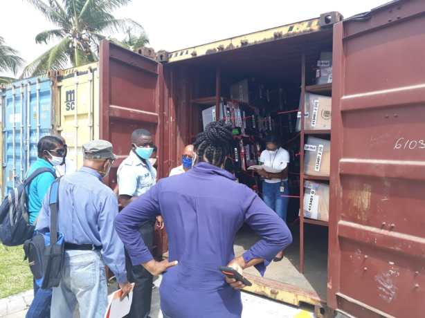 Containers with the ballot boxes being opened by GECOM officials
