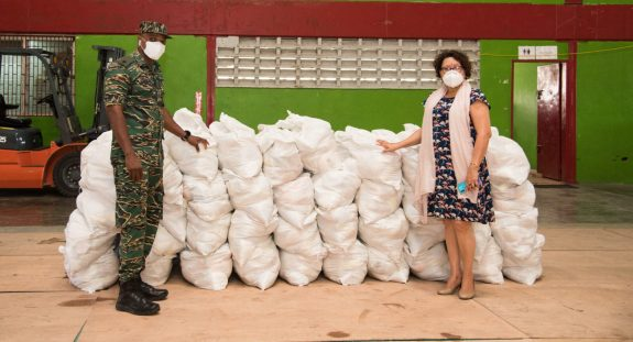 (left to right) Minister within Ministry of Indigenous People's Affairs Valerie Garrido-Lowe handing over food hampers to Major Loring Benons attached to the Civil Defence Commission (CDC)
