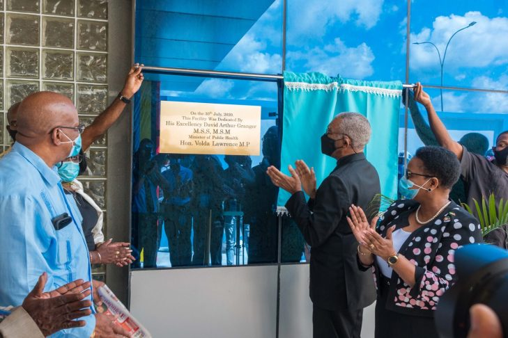 His Excellency President David Granger unveils the commemorative plaque of the Centre for Disease Control and Prevention. Looking on are (right) Minister of Public Health Volda Lawrence and (left) minister of Finance Winston Jordan