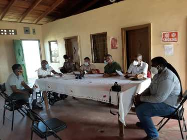 Minister of Natural Resources, Hon. Vickram Bharrat (fourth from left), Minister of Labour, Hon. Joseph Hamilton (second from right), GFC's Forestry Commissioner, Gavin Agard (third from right) meeting with members of the Ituni Small Loggers and Chainsaw Operators Association