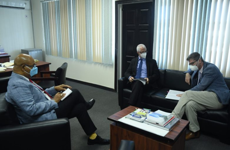 Minister of Public Works, Hon. Bishop Juan Edghill, discusses areas of mutual interest with the British High Commissioner, His Excellency, Gregory Quinn, and Deputy British High Commissioner, Ray Davidson