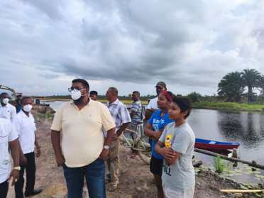 His Excellency, Dr, Mohamed Irfaan Ali, shares a moment with residents of canal Number 1, West Bank of Demerara.