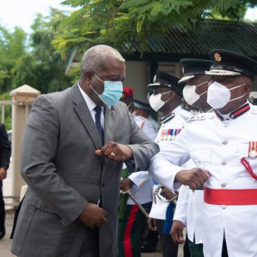 Prime Minister Brigadier Mark Phillips greets greets Fire Chief Marlon Gentle on arrival to the Inauguration Ceremony at the National Cultural Centre (NCC)