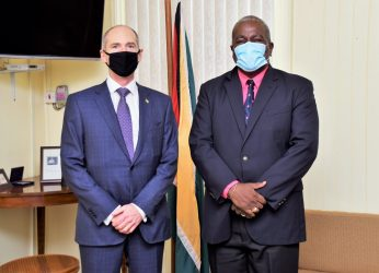 Prime Minister Brigadier Mark Phillips (right) and Country Director of Esso Exploration and Production Guyana Limited (ExxonMobil) Mr. Alistair Routledge (left) at the Office of the Prime Minister