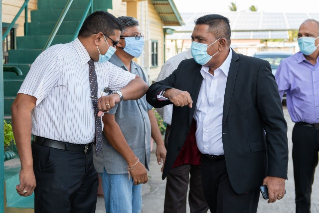 Guyana's Agriculture Minister, Hon. Zulfikar Mustapha greets staff at the GuySuCo head office