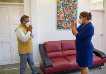 High Commissioner of India to Guyana, His Excellency Dr. K. J. Srinivasa greets Minister of Education, the Honourable Priya Manickchand with a token of appreciation