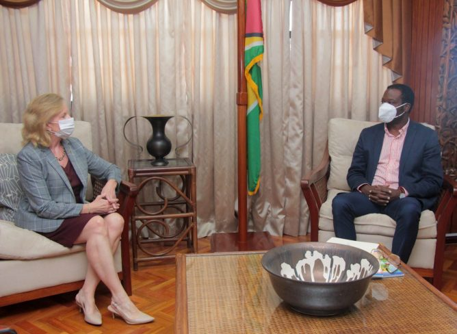 US Ambassador to Guyana, Her Excellency, Sarah-Ann Lynch [left], and Minister of Foreign Affairs and International Cooperation, Hon. Hugh Todd, exchange views during a courtesy call