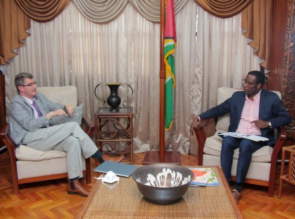 High Commissioner of the United Kingdom, His Excellency, Greg Quinn [left], and Minister of Foreign Affairs, Hon. Hugh Todd [right], discuss cooperation during a courtesy call.