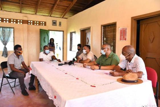 (from right) Minister of Labour, Hon. Joseph Hamilton, Guyana Forestry Commissioner, Mr. Gavin Agard, Minister of Natural Resources, Hon. Vickram Bharrat, Secretary for Ituni Small Loggers Association (ISLA) Mr. Linden Duncan and a member of ISLA in discussion.