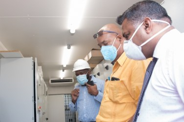 Public Works Minister Hon.Bishop, Juan Edghill and Minister Hon. Deodat Indar and Plant Manager Troy Halley inspect the facility.
