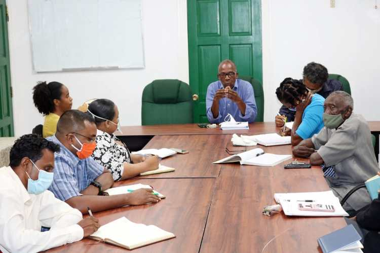 Labour 2: Minister of Labour, Hon. Joseph Hamilton, and staff of the Ministry of Labour during their first meeting.