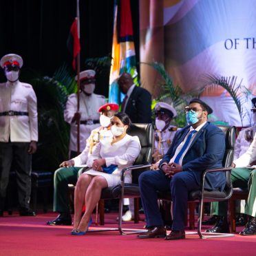 Executive President of Guyana, His Excellency, Dr. Mohammad Irfaan Ali and First Lady, Her Excellency Arya Ali on stage at the National Cultural Centre at the inauguration event.